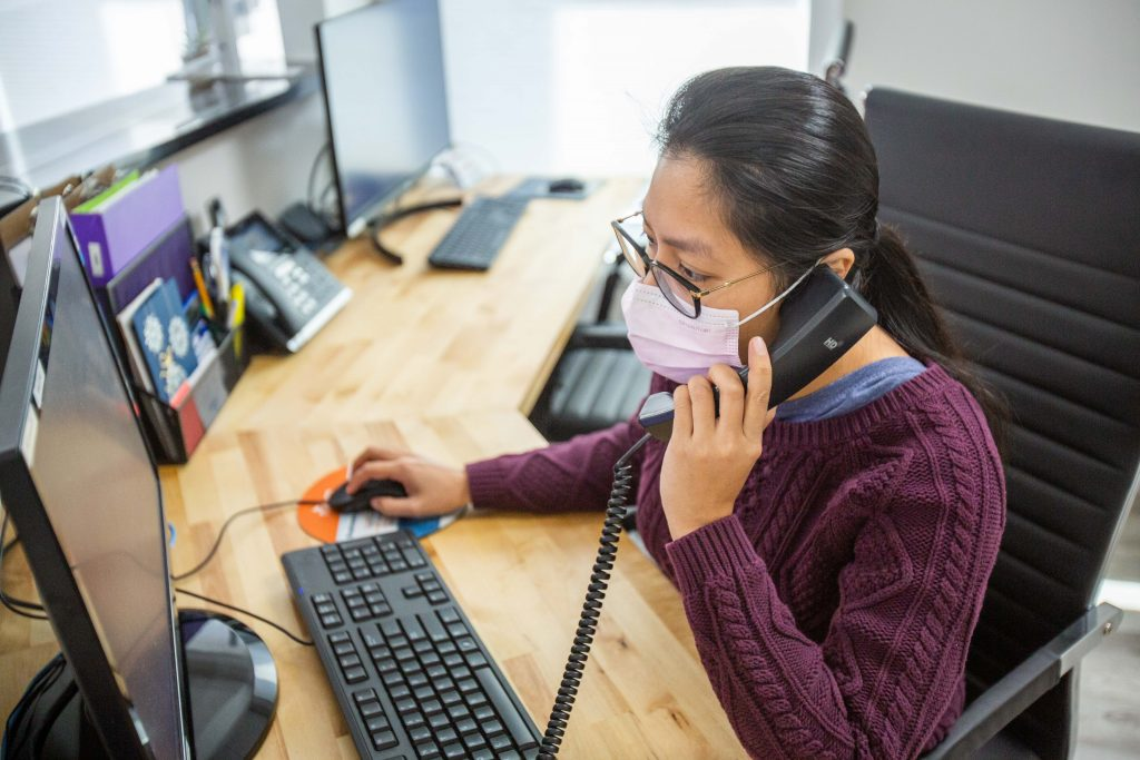 Dr.Minh helping a patient over the phone | Salem, NH