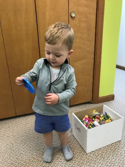 Picking some fun toys from the toy box! | Salem, NH